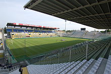 A view of a football pitch and the stands surrounding it from the view of one corner.