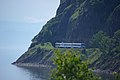 Excursion train of Circum-Baikal railway- ED9MK-0029 EMU under TEM2-6550 (31896327110).jpg