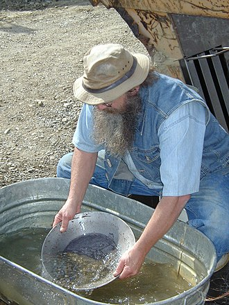 Alaskan Independence Party - Dexter Clark, shown in May 2002 demonstrating gold panning to tourists at the El Dorado Gold Mine, is a former chairman of the AKIP.