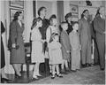 Family members of W. John Kennedy and John L. Sullivan, the Undersecretary and Secretary of the Navy, watch the oval... - NARA - 199637.tif