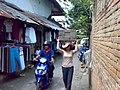 Female laborer transporting concrete blocks in Bali.jpeg