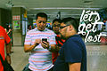 Filipino tourists using an iPhone in a Mass Rapid Transit station, Singapore (title card) - 20140213.jpg