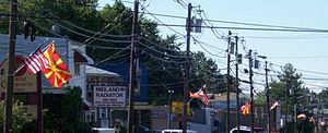 Macedonian Americans - Macedonian and American flags on the streets in Garfield, New Jersey on Macedonian Independence Day.