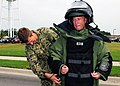 Flickr - Official U.S. Navy Imagery - A Sailor puts on a bomb suit..jpg