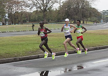 Kipchoge (shown left) en route to his Olympic gold medal, 40 minutes until the finish. Rupp (middle) and Talisa (right) following him.
