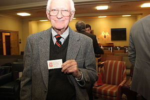 Dummy corporation - Former Iran hostage holding his fake Studio 6 card.
