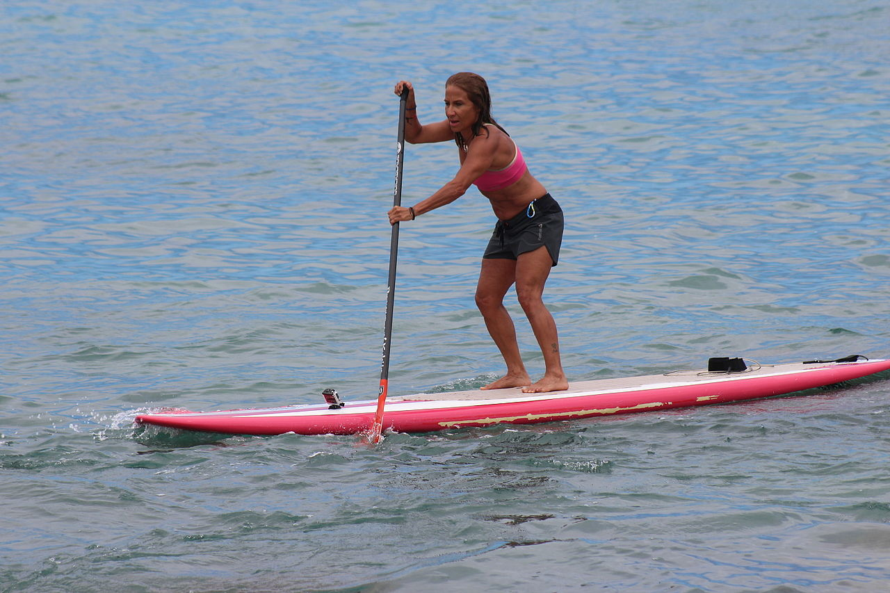 woman doing standup paddleboarding