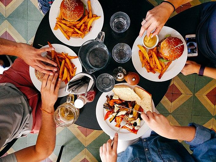 Friends eating lunch in diner (Unsplash).jpg