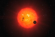 The newly discovered super-Earth surrounding the nearby star GJ 1214.