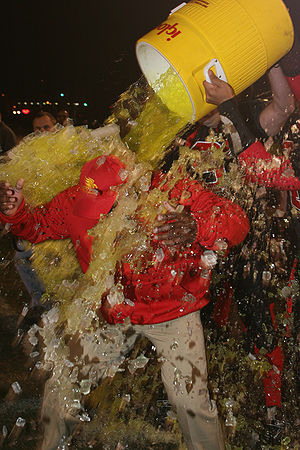 Gatorade shower - The coach of a Marine Corps league football team is showered with Gatorade following his team's championship victory