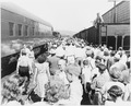 General view of the crowd at the train station greeting President Truman's train on its way to Bolivar, Missouri so... - NARA - 199877.tif