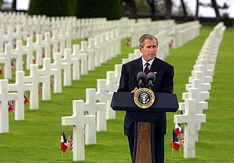 Timeline of the George W. Bush presidency (2002) - President George W. Bush at the Normandy American Cemetery at Normandy Beach in France, May 27, 2002.