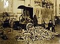 German boy splitting wood along with power saw (32140188252).jpg