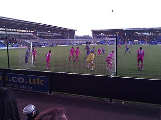 2011–12 Gillingham F.C. season - Goalmouth action from the game away to Shrewsbury Town in January (Gillingham in pink)