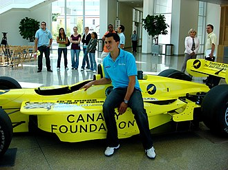Graham Rahal - Rahal posing with a show car when he raced in Champ Car in 2007