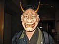 Guy in oni Noh mask.jpg