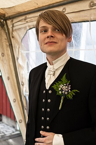 Formal wear - An Icelandic man wears the ''hátíðarbúningur'' formal dress on his wedding day along with a boutonnière.