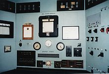 A control panel with lots of switches and meters