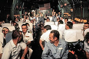 "Hanoi Taxi - Recently released United States POWs from North Vietnamese prison camps being flown on board the ""Hanoi Taxi"" from Hanoi, North Vietnam to Clark Air Base, Philippines, March 1973."