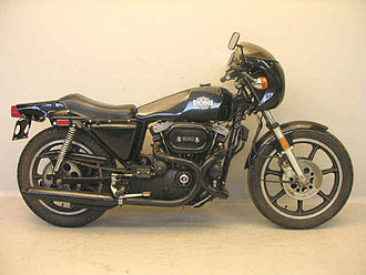 Motorcycle wheel - A 1977 Harley-Davidson XLCR with seven-spoke alloy wheels manufactured by Morris