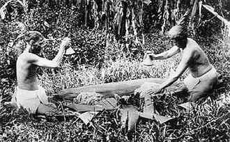 Poi (food) - Hawaiian men pounding poi, c. 1890
