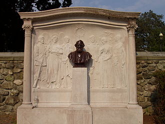 """The Village Blacksmith - The title character of """"The Village Blacksmith"""", third from the left, depicted in the Longfellow Memorial by Daniel Chester French and Henry Bacon, Cambridge, Massachusetts"""