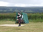File:Highland games bagpiper 2.JPG