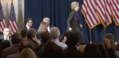 Hillary walking on stage to deliver her concession speech 02.png