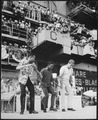 Hollywood comedian Bob Hope joins dancers Harold and Fayard Nicholas in a dance step aboard the U.S. aircraft carrier Ti - NARA - 541852.tif