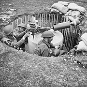 Home Guard soldiers operate a 'Blacker Bombard' spigot mortar during training at No. 3 GHQ Home Guard School at Onibury near Craven Arms in Shropshire, 20 May 1943. H30181