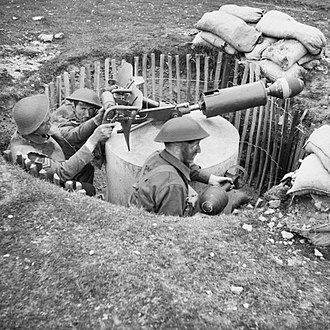 Home Guard (United Kingdom) - Home Guard soldiers training with a Blacker Bombard anti-tank mortar in May 1943.  The mortar is mounted on a concrete pillar in a pre-prepared pit; of which around 18,000 were dug