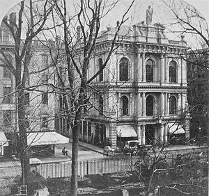 "Massachusetts Horticultural Society - Horticultural Hall dedicated in 1865 on Tremont Street, Boston. Note the statues at the corner of the second floor and on the roof which are now displayed in the ""Garden of the Goddesses"" at Elm Bank Horticulture Center."