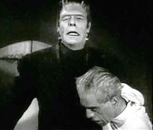Glenn Strange - Strange as Frankenstein's monster, with Boris Karloff, in the horror film, House of Frankenstein