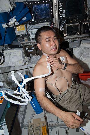 Koichi Wakata - Wakata demonstrating medical ultrasound equipment during Expedition 38.