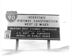 Transportation in Montana - Construction sign for I-90 in Montana during the mid-20th century