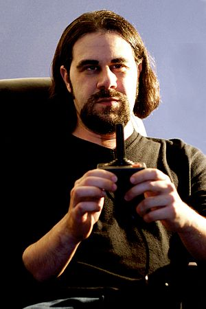 Ian Bogost - Bogost (top) with an Atari VCS joystick