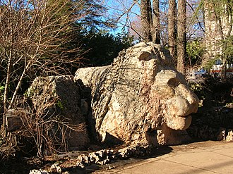 Ifrane - Sculpture of a lion in a park of the city
