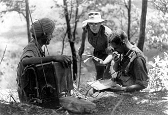 Battle of Imphal - On Imphal front, Sikh signaller operates wireless for British officers, listening to patrols reporting Japanese positions.