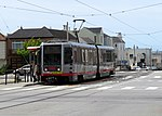 Inbound train at Taraval and Sunset, May 2018.JPG