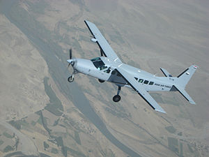 52d Expeditionary Flying Training Squadron - An Iraqi Air Force Cessna 208 flies over Iraq on a training sortie.