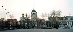 Irkutsk, Siberia 1990 Church Of Our Saviour and memorial.jpg