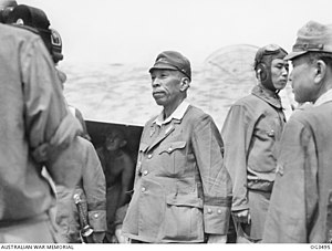 Masao Baba - Lieutenant General Masao Baba (Centre) at Labuan airstrip to sign the surrender document at the 9th Division Headquarters on 9 October 1945.