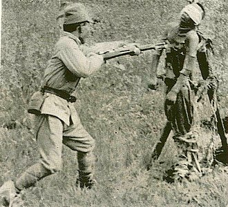 Japanese war crimes - Japanese bayonet practice with a dead Chinese near Tianjin