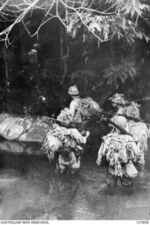 Battle of Slim River - Japanese troops crossing a jungle stream.