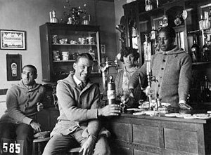 José Leandro Andrade - Andrade (behind the bar) serving a drink to his Uruguayan teammates in Amsterdam (1928).