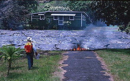 Lava can easily destroy entire towns. This picture shows one of over 100 houses destroyed by the lava flow in Kalapana, Hawaii, United States, in 1990. Kalapana house destroyed by lava.jpg