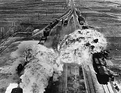 A bomb explodes on a moving train.