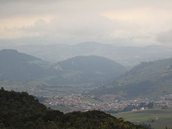 La Calera viewed from a mountain to the west, just before a storm