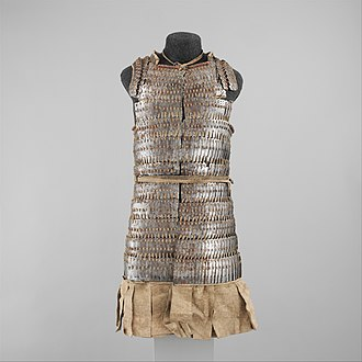 16th century Tibetan lamellar armor. Composed of iron and leather overlapping, interlocking squares designed to reduce the force of an impact. Lamellar Armor (Byang Bu'i Khrab) MET DP113384.jpg