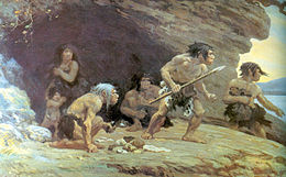 A group of four Neanderthal men, one woman, and her naked son standing on a rock platform with a cave behind them, looking worriedly off to the right. The men are wearing only furs wrapped around their waist, one has a spear, and another is crouching with food in his hand. The woman is standing inside the cave, has a fur pulled up to her collarbone, and is holding her son close